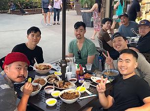 mens group outside eating.jpg