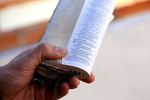 hand holding bible isaiah 42.jpg