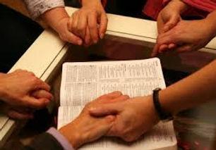 praying together hands.jpeg