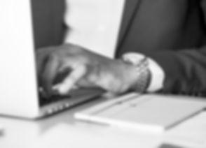 adult-businessman-desk-1059122_edited_edited.jpg