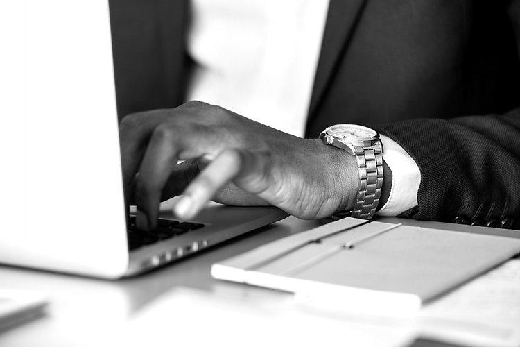 adult-businessman-desk-1059122_edited.jpg