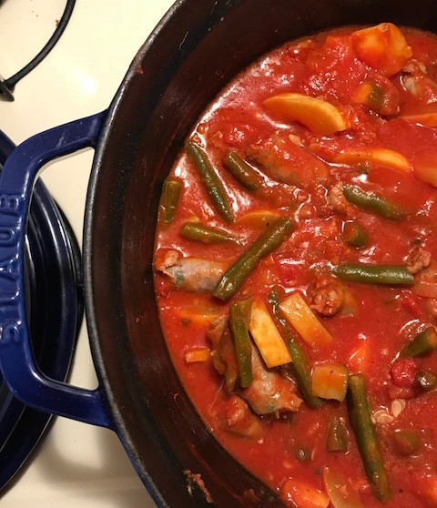 A hearty stew with vegetables and sausage!