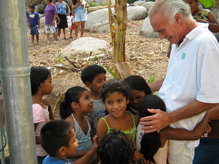 Dr. Hoefflin with a happy group of children