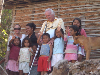 Dr. Hoefflin with some happy children in the community