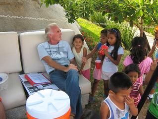 DR. HOEFFLIN TEACHING THE POOR CHILDREN AT VILLA PAMELA