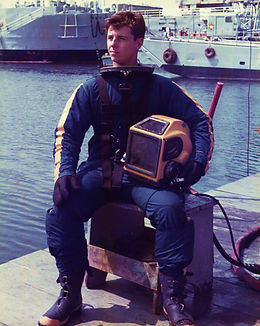 Austin Haynes, author of The Queen of Kings and Ironclad Gold in Navy SCUBA gear
