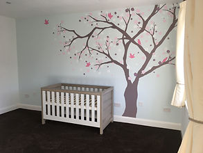 Cherry tree mural in baby girl's nursery oo