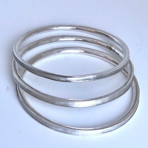 Anticlastic pure silver bangle