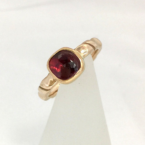 Translucent Garnet Cabochon set in 10K gold