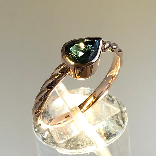 Pear shaped green tourmaline set in 18K pink gold