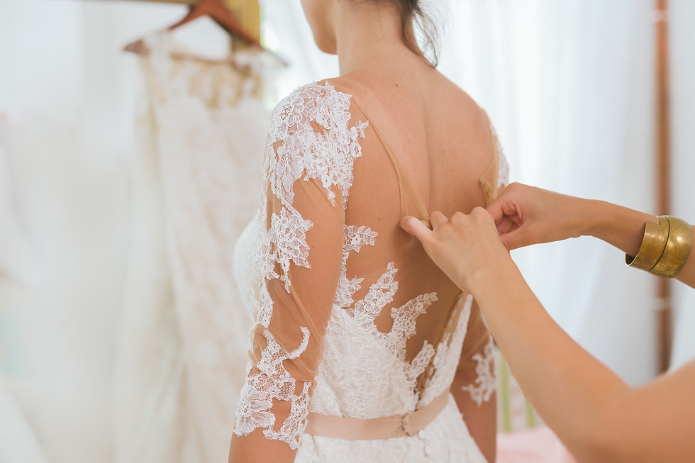 Helping the bride to put her wedding dress on