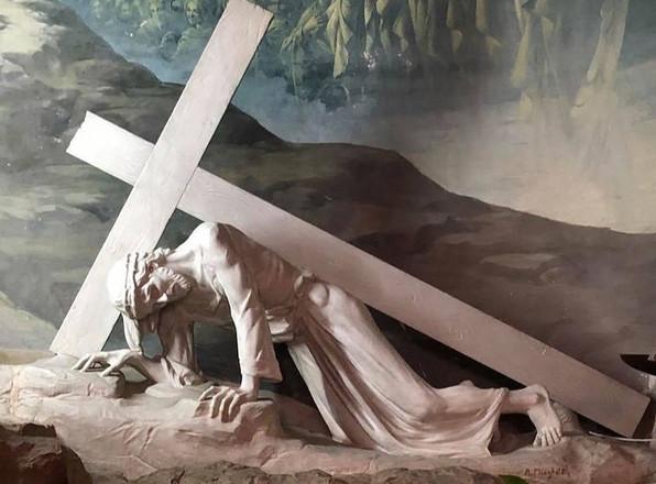 Station 7: Jesus carries his cross.