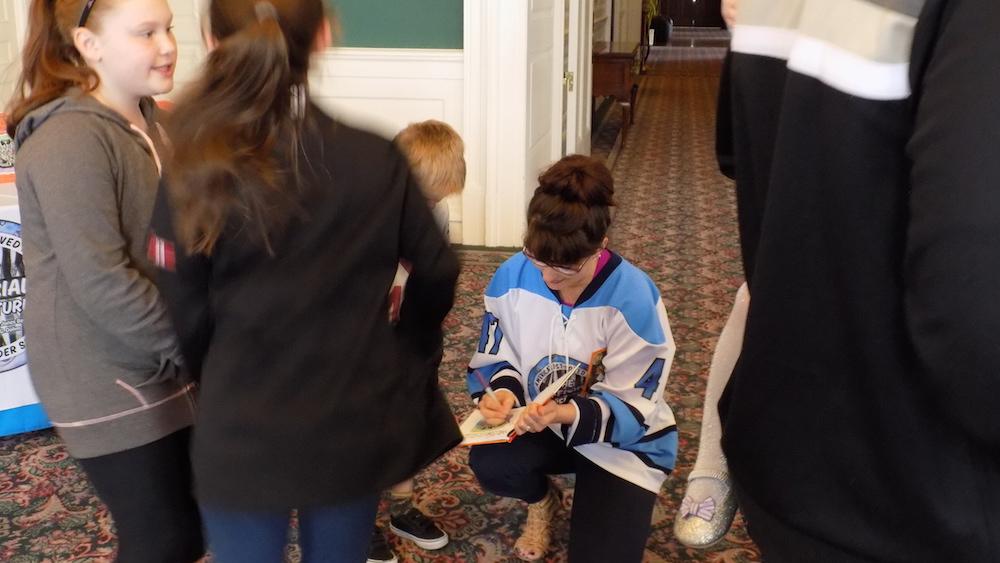 Katrina signs Kyle's book!