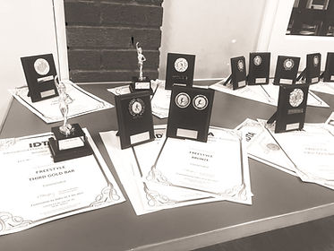 A picture showing some dancing awards that dancers received after completing their exams.