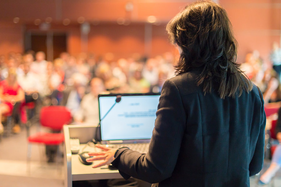 Business woman lecturing at Conference.