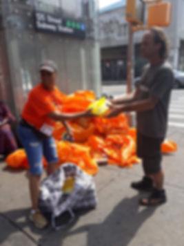 Charlotte Brown helps serve Harlem man a free Sunday dinner