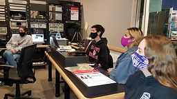 Executive Producer Matthew Yahata in the control room with Producers Chloe Hooper and Savanna Birchf