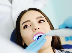 beautiful girl at the dentist. Dental fi