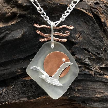 Gull and sand dollar pendant