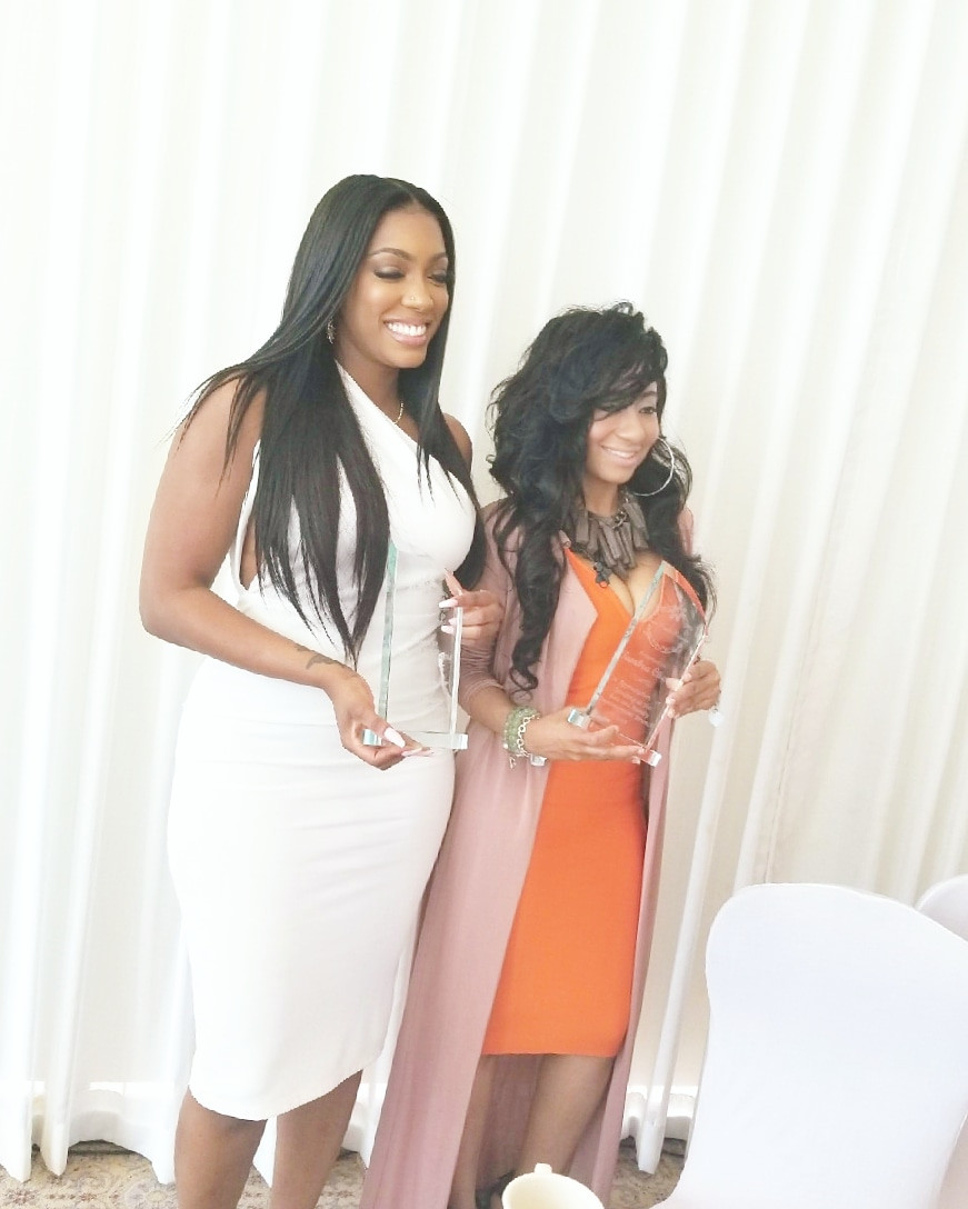 Porsha Williams and Tambra Cherie receiving appreciation award