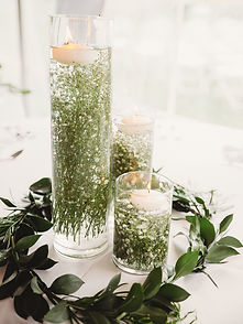 Baby's Breath submerged in tall glass cylinders. Wedding centrepiece