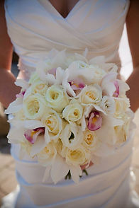 Stunning bridal bouquet with roses and orchids