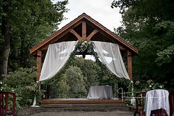 Exterior Gazebo draping adds elegance to rustic elements