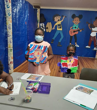 Children display paintings from arts & craft class