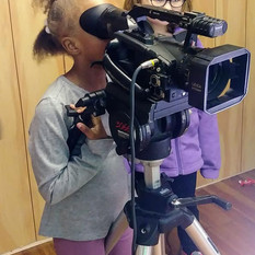 Students using a pro video camera.jpg