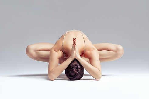 Flexible Pilates stretch being held