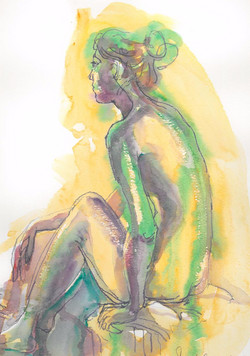 woman sitting purple and green