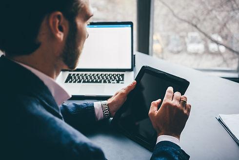 businessman-working-on-digital-tablet-cl