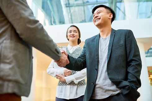 greeting-business-partner-with-handshake