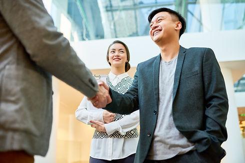 greeting-business-partner-with-handshake