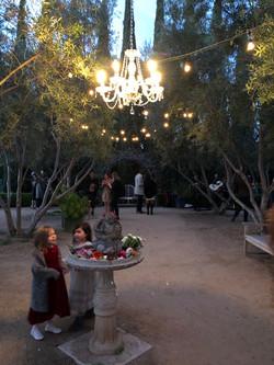 Elisa & Nick's Garden Wedding Ceremony Fountain Flowers with Children