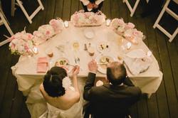 Jinah & Newton at sweetheart table