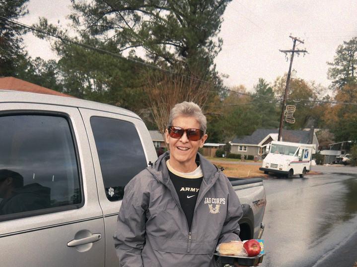 Volunteer Delivering Gift and Meal