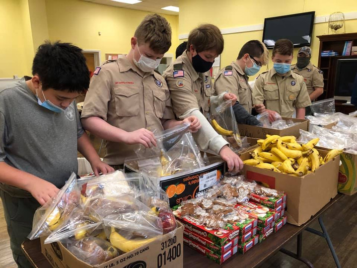 Boy Scout Troop 115 heping with meal prep