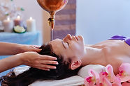 Young woman having pouring oil massage