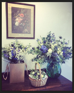 Bouquet, basket of button holes and vase