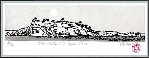 SUN OVER THE HEADLAND> Lino/block print