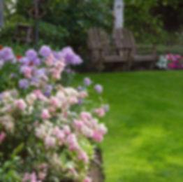 Beautiful garden with adirondack chairs