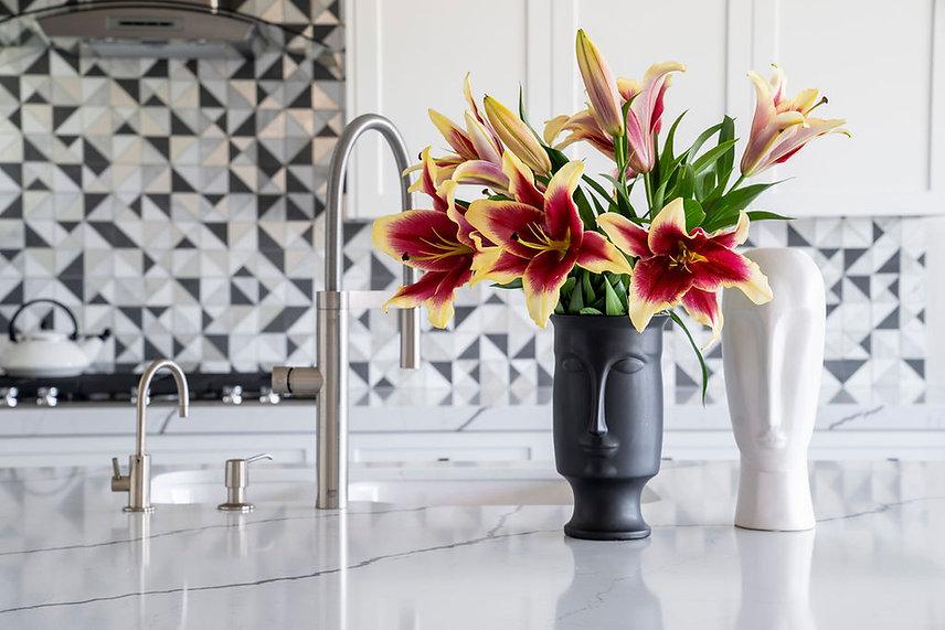Black and White Kitchen, Johnathan Adler vase, Oceanside glass tile, Golden Interior Design, Bella Golden