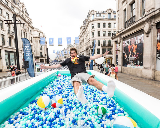 FITBIT 'SUMMER STREETS'  An experiential activation as part of Regent Street Summer Streets, we created a giant inflatable ball pit filled with 80,000 brand coloured balls for the Fitbit 'Pump It Up' campaign.  Working with House of Dinosaur we ran two days of activities, competitions and kids free play with members of the public winning the latest Fitbit products.  Alongside the ball pit we created a number of branded assets including tiered seating units, leader boards, lifeguard chairs and a product/retail zone.