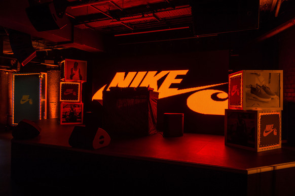 NIKE x CARHARTT  Working with the Nike NBHD team we designed and installed a custom Carhartt X Nike set for the launch event celebrating the collaboration between these two iconic brands. Alongside the event were site specific installations for three of Londons most iconic sneaker stores: Footpatrol, Offspring and Sneakersnstuff.  Incorporating original Carhartt WIP fabrics, printed graphics, raw concrete product displays and lighting units into the builds we created bespoke POS units and a stage set designed to amplify the campaign messaging and both brands' core aesthetic.