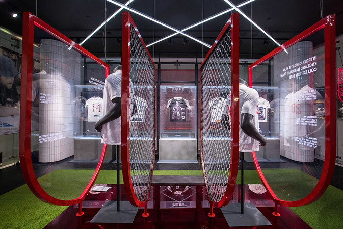 NIKE WHITE SHIRT PROJECT  We were commissioned to design, produce and execute the White Shirt Project at NikeTown London. Featuring x11 bespoke shirts created by Tottenham Textiles in collaboration with Nike, we developed a series of premium acrylic display units alongside two 'atelier' cases to showcase the 'making' process for two of the community teams involved.  The content of the exhibition was a collaborative effort from Nike and Tottenham Textiles consisting of x11 bespoke England shirts, each telling a different fearless story. These stories were then communicated through the exhibition build, live event and supporting assets