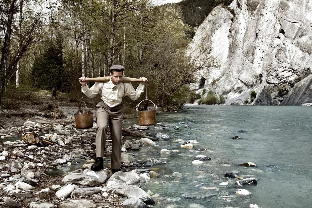 Wasser in den Rhein tragen