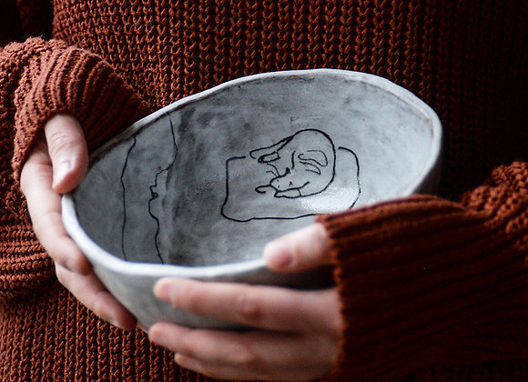 Bowl with the story of the ball