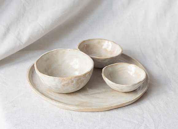 Handpinched bowls and plate, spectrum