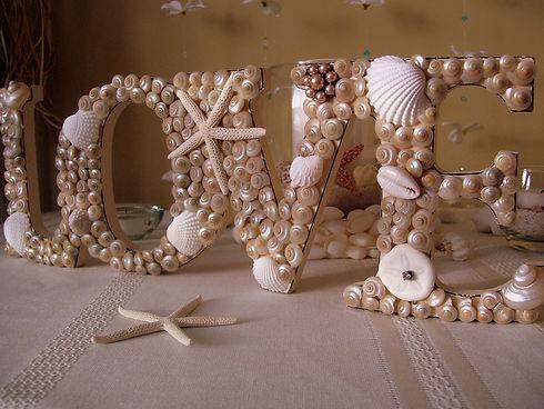 seashell-covered-love-sign-beach-wedding